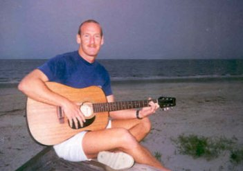 ''Strumming my six-string'' on the beach in Georgia.