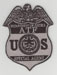 The Bureau of ATF badge (Dept. of Justice).