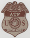 The Bureau of ATF badge (Dept. of Justice), desert colors.