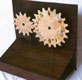 A wooden Aztec Calendar with moving gears.