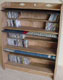 A fake bookcase concealing six shelves for CD storage.
