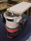 A router jig used to trim debris even with the work surface.